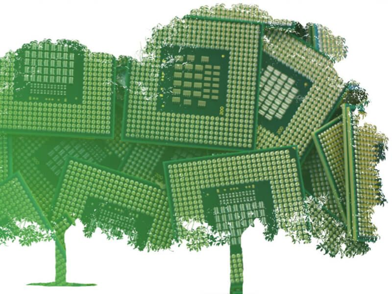 Fanciful illustration of transparent silhouettes of green trees placed over images of microelectronics wafer chips