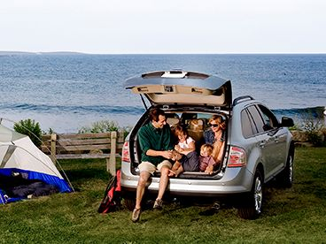 Open liftgate with family camping