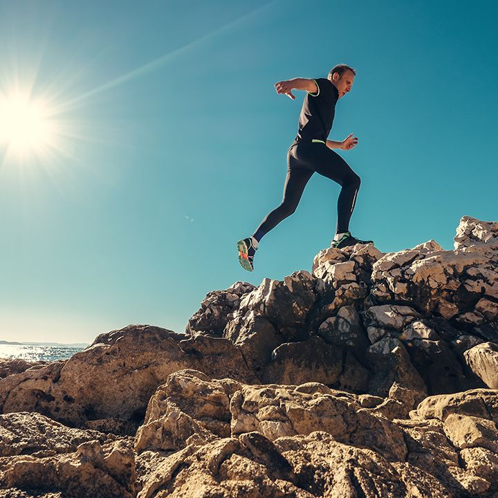 Man running on rocks.