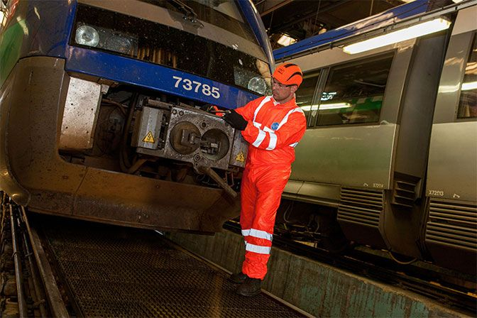 An SNCF railway worker wears Tyvek® coveralls to stay safe on the job