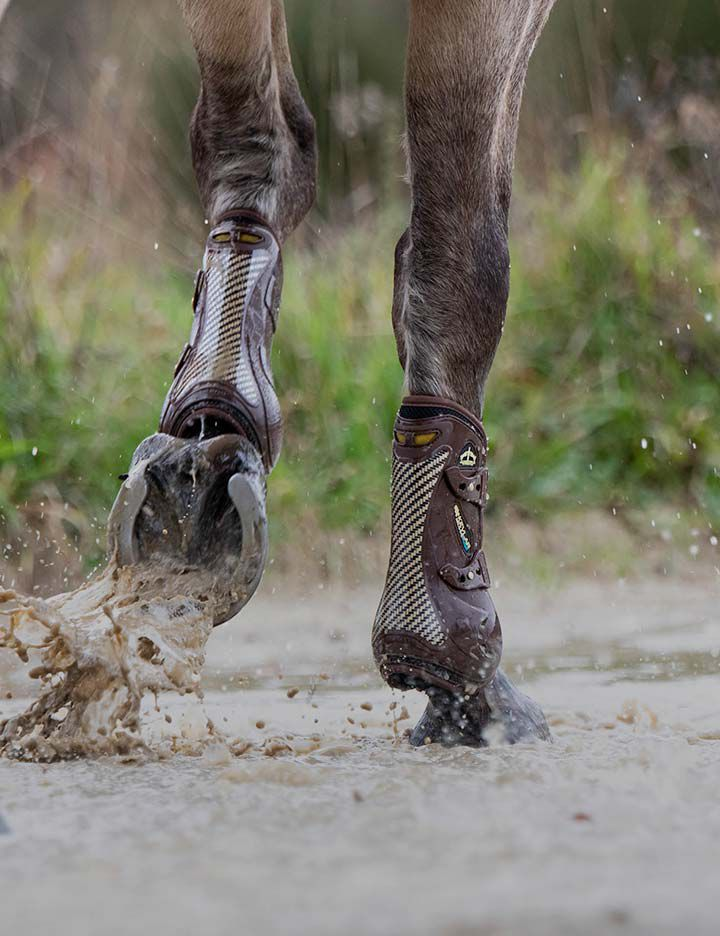 Veredus® Kevlar® open front boots providing lightweight protection and impact resistance for a horse