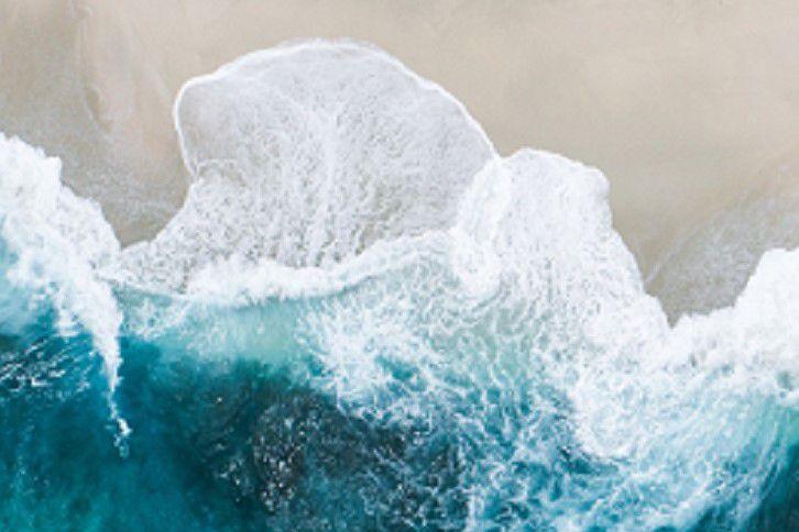 Seawater crashing on beach