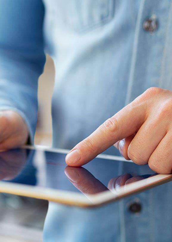 Guy scrolling on tablet screen.
