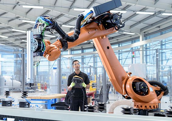 Engineer operating robotic manufacturing equipment