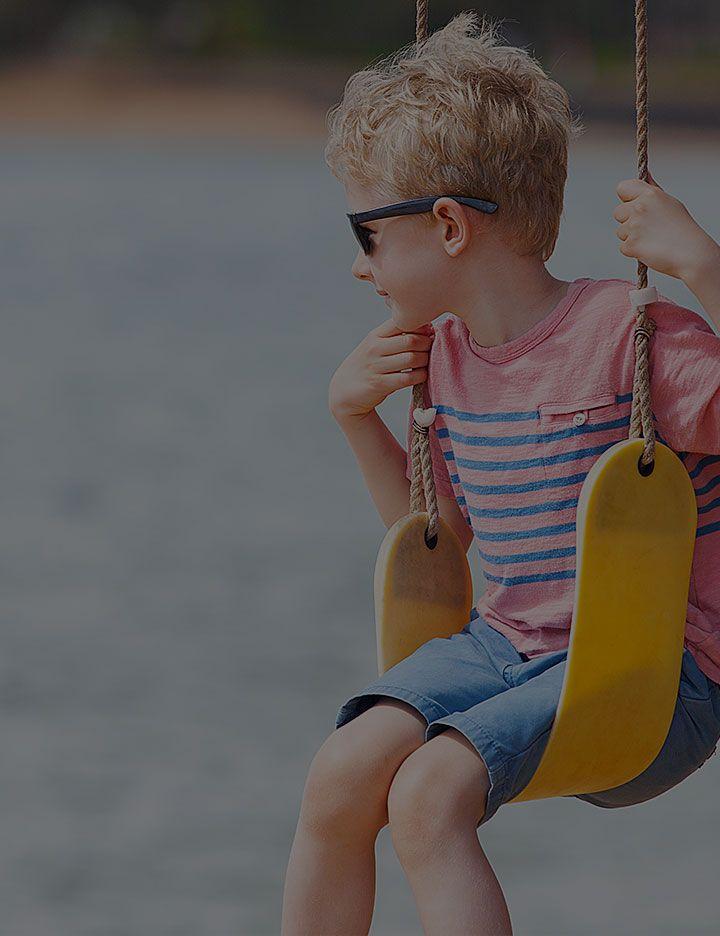 Boy on swing image