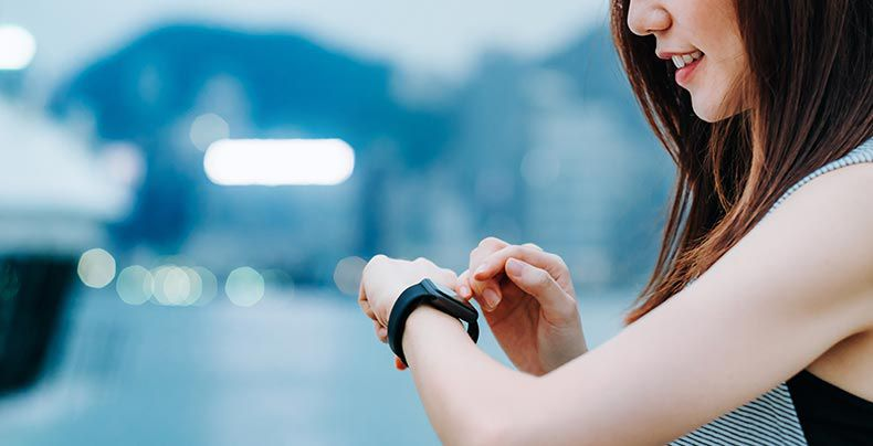 Woman interacting with smart watch on her wrist as example of electrical technology solutions from DuPont