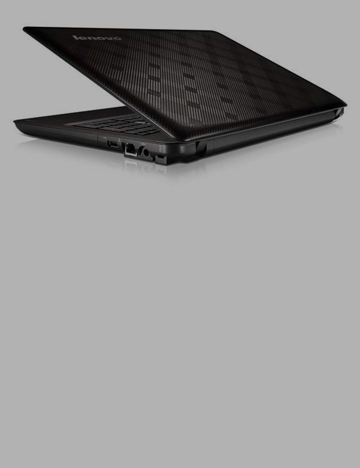 Tabletop image of laptop computer exemplifying thinner, lighter housings for electrical devices from DuPont
