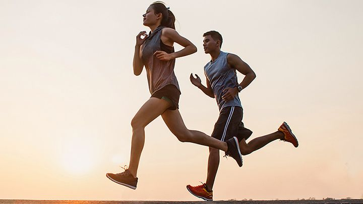DuPont consumer product design in action. A man and woman jogging together under a clear sky