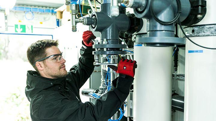 Service respresentative man provides technical support on ultrafiltration system