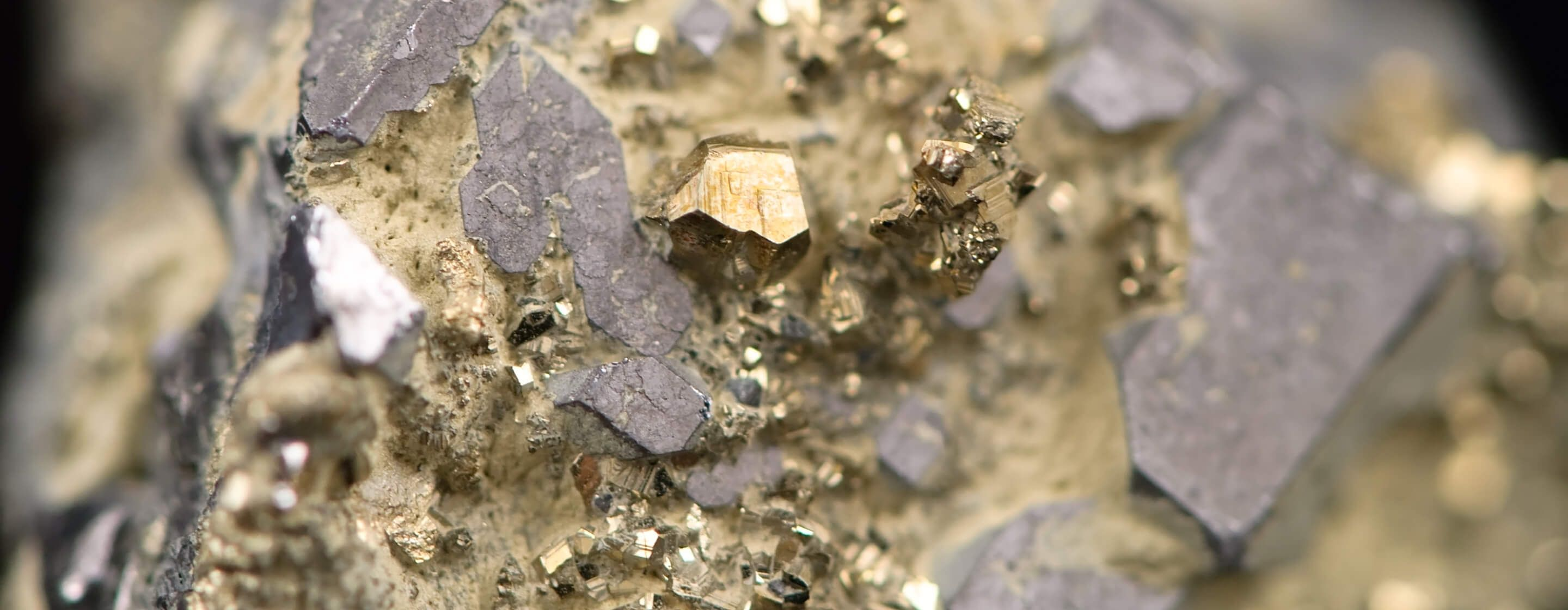 Extreme close-up of raw gold in its mineral form in mother rock from gold mining