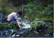 Boy by the stream