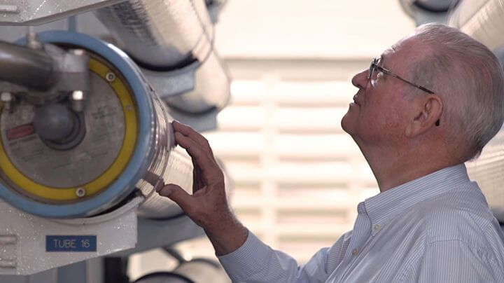 Person inspecting an installed FilmTec Fortilife reverse osmosis element